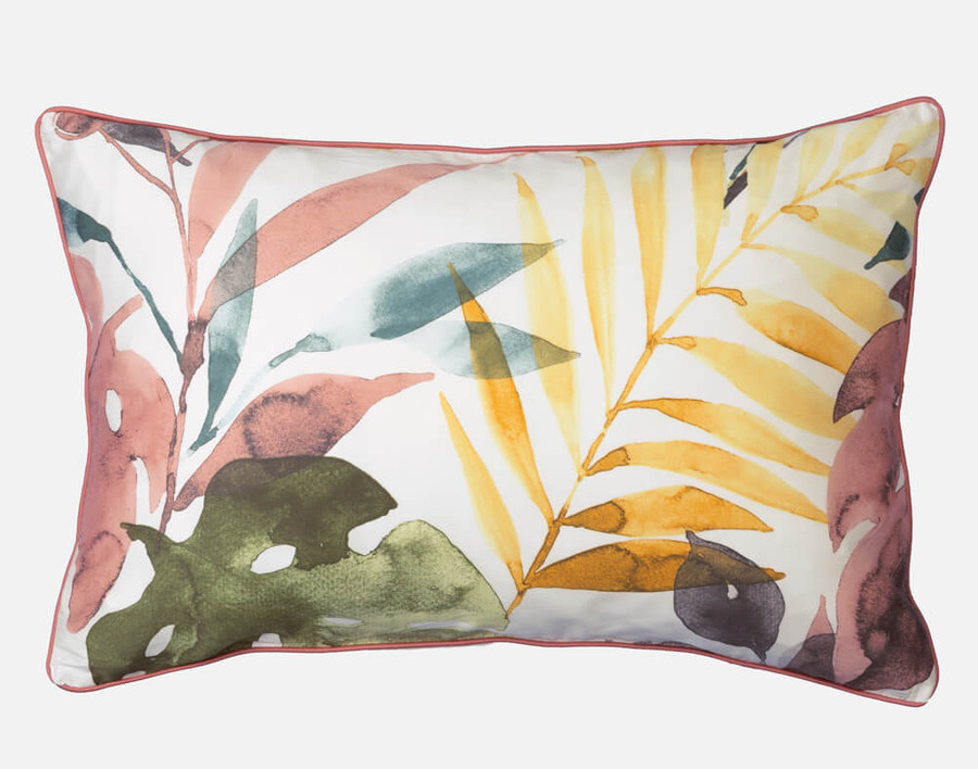 Mahana Pillow Shams are finished with terracotta orange piping and reverse to the subtle tropical palm frond pattern on a white background.