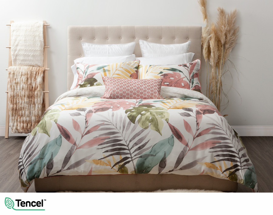 Mahana Duvet Cover Set features oversized tropical leaves in shades of teal, gold, terracotta and charcoal on a white background to transform your bedroom into an island sanctuary.