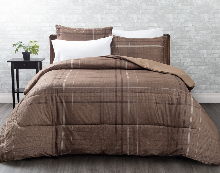 The Salvio Comforter Set comes in a light brown with subtle white and dark brown pinstripes.