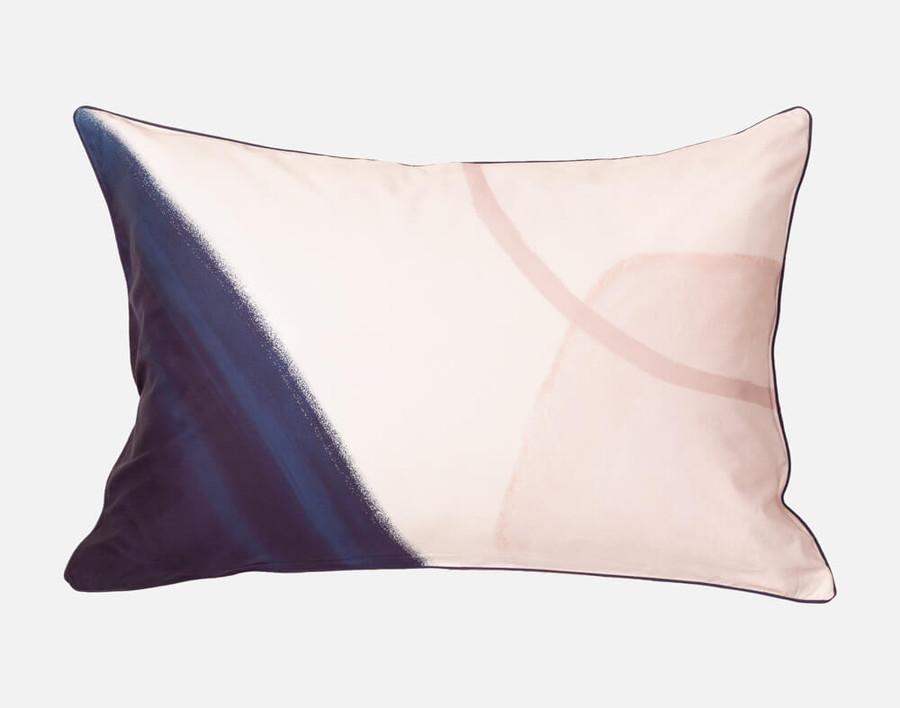 Memphis Pillow Sham features a bold navy blue corner on a soft blush pink background.