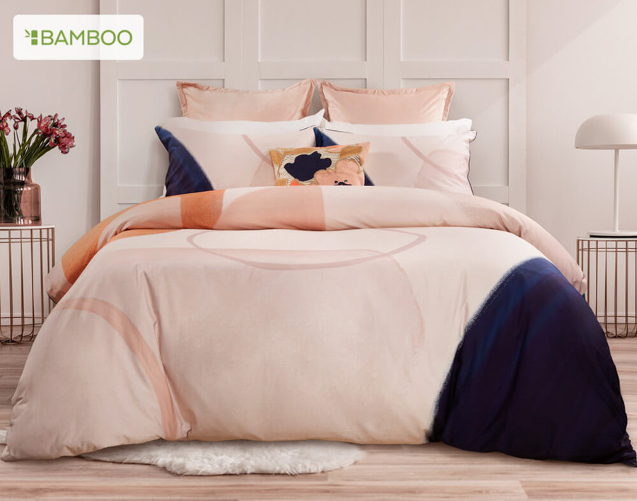 Memphis Bedding Collection is a perfect combo of blush and coral offset with a bold corner of deep ink blue.