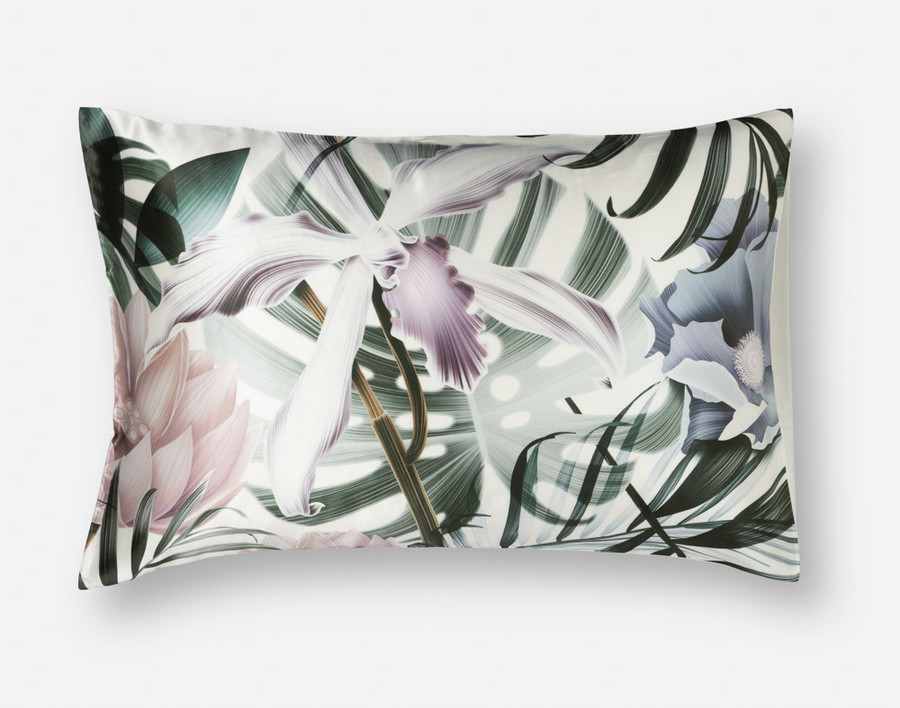 100% Silk Pillowcase in Jungle Floral, featuring tropical flowers on a bed of monstera leaves.