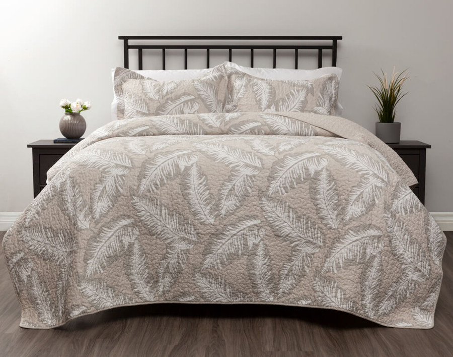 Rattan Cotton Quilt Set features off-white rattan leaves on a stone beige background.