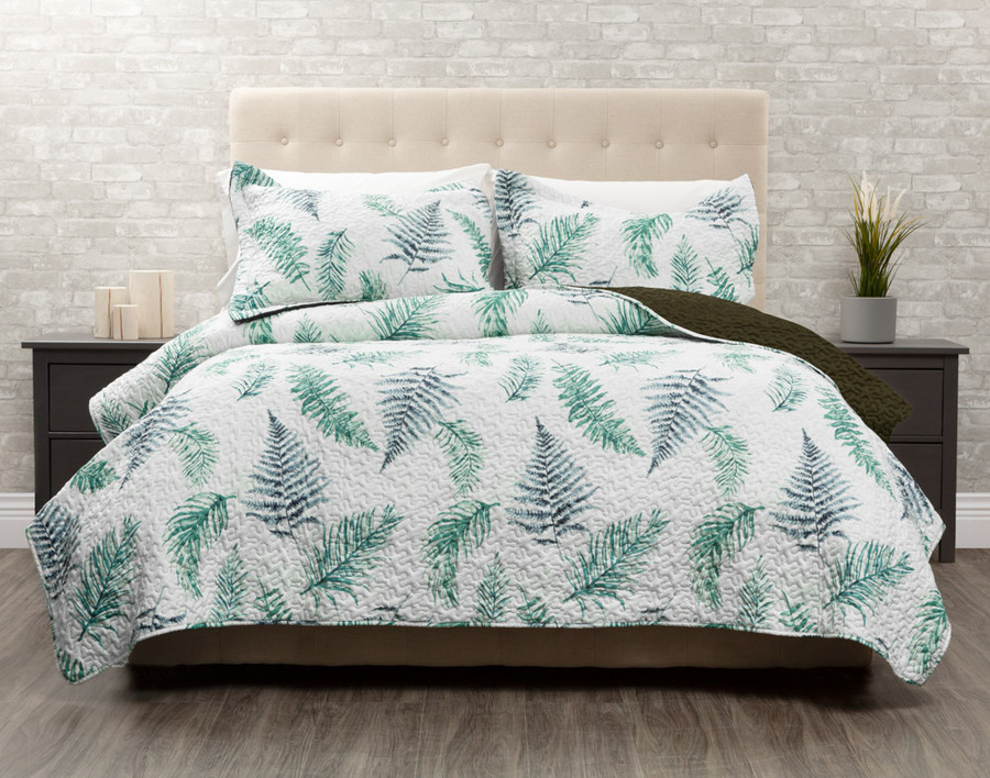 Forest Fern Coverlet features blue and green ferns on an white background.