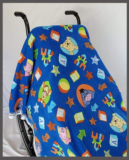 Pooh on Medium Blue Fleece Wheelchair Poncho