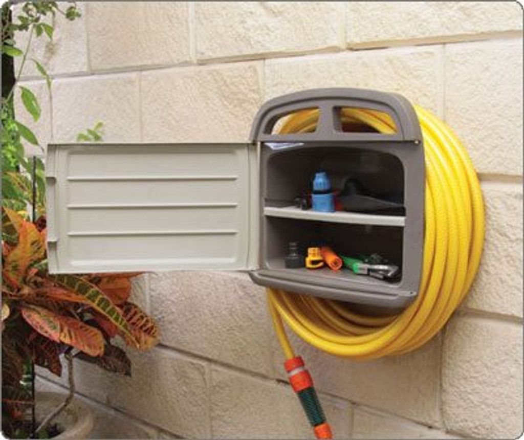 Hose hanger outside in the garden with tools