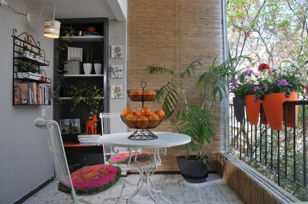 Indoor view of Greenbo orange railing planters.