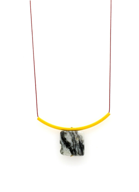YELLOW BRASS WITH BLACK AND WHITE MARBLE ON RED SILK