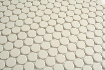 Off white unglazed porcelain penny round mosaic