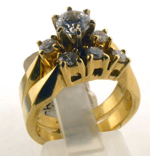 14 karat yellow gold and diamond wedding set. Center stone is CZ. The Dia TW is .16ct on engagement ring. The total weight of the rings are 8.4 grams. This is made for a finger size of 6.25.