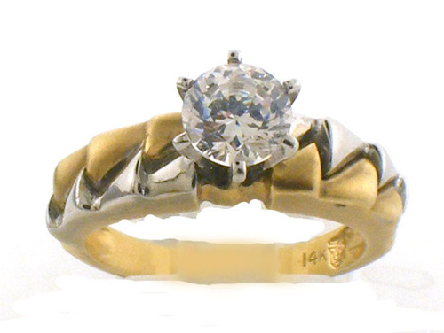 14 karat two tone remount ring .