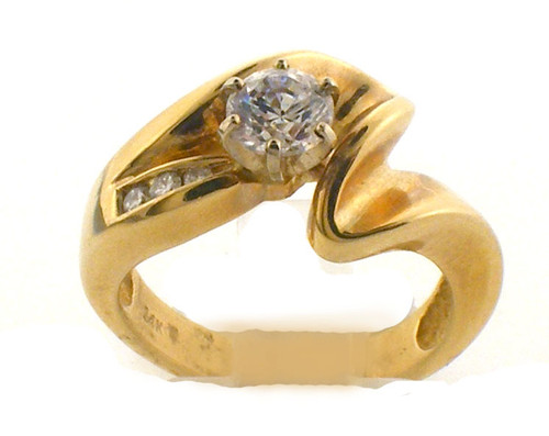 14 karat yellow gold remount ring. Diamonds weigh .05ct TW