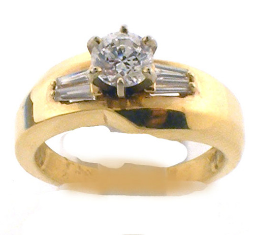 14 karat yellow gold diamond remount ring.  Ring contains .24 carats total weight