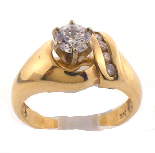 14k yellow gold remount ring with cubic zirconia center. diamonds weight .09 ct tw.