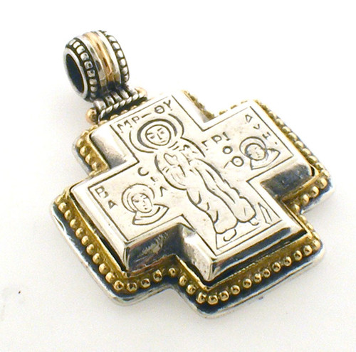 18k and sterling silver cross pendantg weighing 13.5 grams.