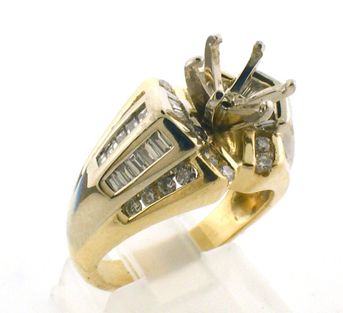 14k gold remount ring. size 6.5 weighing 8.2 grams. 24 Round Brilliant Cut at .36 ct and 34 Baguette cut at .68 for a total diamond weight of approximately 1.0ct