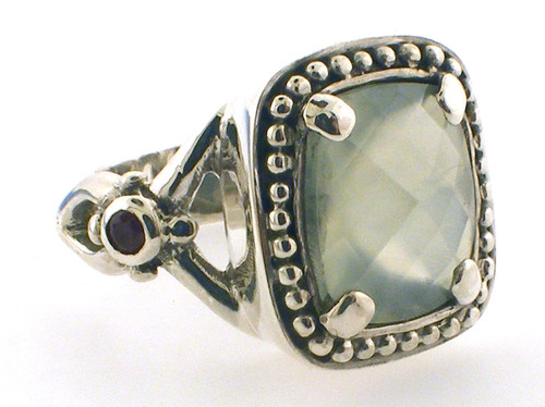 Sterling silver green stone ring weighing 8.3 grams finger size 5