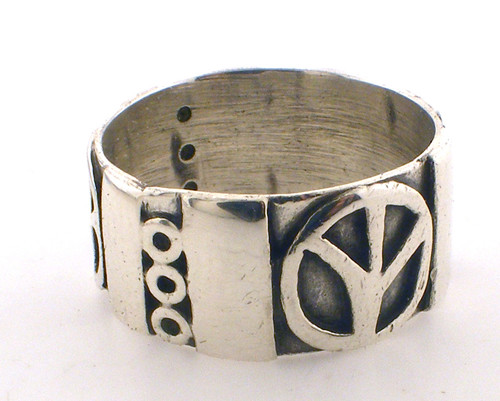 Sterling silver stamped mexico peace sign ring weighing 8.5 grams, sz 11