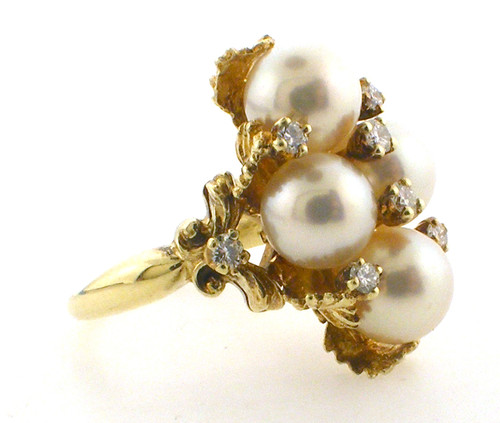 14 karat yellow gold pearl and diamond ring weighing 9.7 grams. Diamond weigh approx .25ct tw. Pearls are 7.5mm each