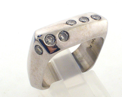 14 karat white gold diamond ring weighing 12.1 grams. Sz 9 Diamonds weigh approx .50ct tw