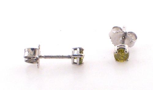14 karat white gold irradiated yellow diamond studs. .16ct tw