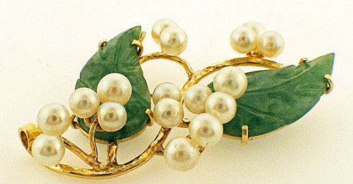 14kt  yellow gold jade an pearl pin weighing 14.6 grams. Contains 17 5.0-5.5