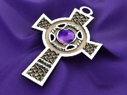 Celtic cross with amethyst center stone and braid around the center stone. in 14K gold, cross weighs 78 grams. This is a CAD design which allows it to be madein different specifications- price will be quoted