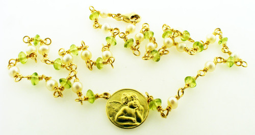18kt yellow gold 15.5 inch pearl and peridot necklace weighing 8.4 brams