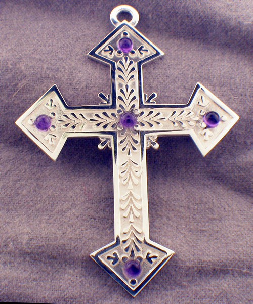 CAD designed amethyst cross with center stone and stone on the end of each arm. Stones are available are either cabachon or faceted. Leaves decorate the arms of the cross. cross is 3 inches in height and weighs 27.5 grams in 14K gold.