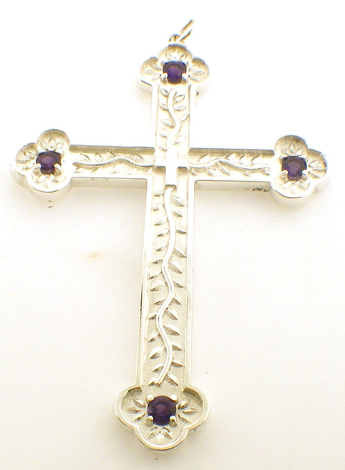 CAD designed decorative pectoral cross with small cross in the center and amethyst at end of each arm. cross is 3 inches in height and weighs 30 grams in 14K gold