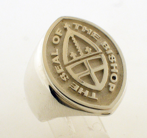 This is a marquise shaped signet ring. It comes in two sizes, 26mm and 20.5mm which is called the mid size. You can purchase the ring as pictured, or you can have your seal customized for the top of this ring. The cost for a customized seal is a one time charge of $300 in addition to the cost of the ring. Please call us to place an order for a custom seal ring.