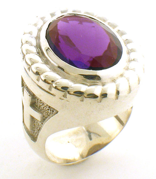 This is the smaller version of the BR102.  It has a 16 x 12 Amethyst center and weighs 31 grams in 14 karat gold.