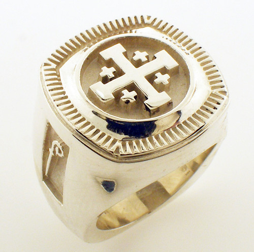 This is one of the heaviest rings we make although not the largest. It is 22 x 22mm in size and weighs 55 grams in 14 karat yellow gold. This top of this ring is shown with a Jerusalem Cross but it can be customized. The sides have a crozier. Please call the store should you wish to create a custom top for this ring. Price will be quoted accordingly.