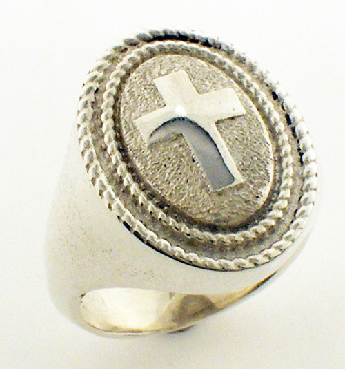 This is a double braided cross ring with plain sides.  It is 23 x 17mm and weighs 36 grams in 14 karat yellow gold.