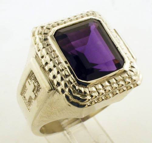This is a rectangular ring with an amethyst stone.  The overall size of the ring is 19 x 17mm with a 12 x 10mm emerald cut amethyst stone.  It weighs 33 grams in 14 karat yellow gold.
