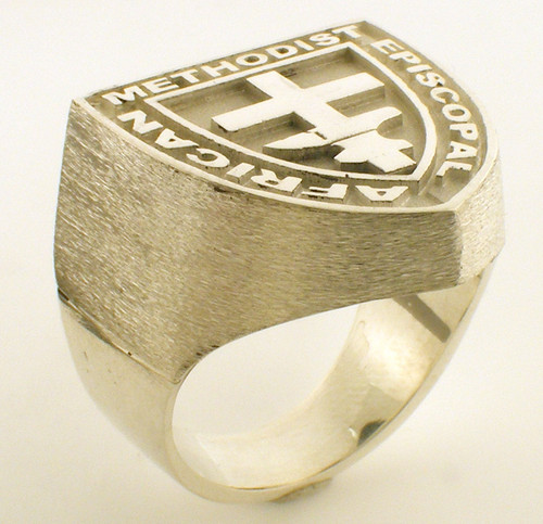 This is our AME ring. Weighs 40.3 grams in 14 karat yellow gold.