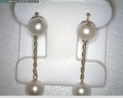 14 karat yellow gold pearl drop earrings. 5.5mm pearls