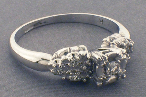 14 karat white gold diamond ring weighing 3.4 grams. Diamond weight is approx .10ct TW  Finger size 8