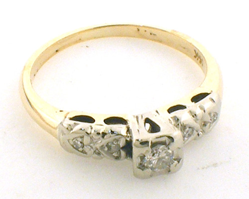 14Karat two tone yellow gold with white gold top. Weighing 2.8 grams. Diamonds weighs apprx .10ct tw. Finger size is 7