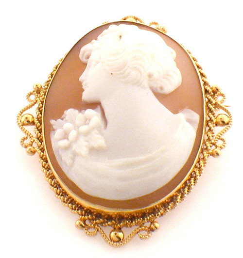 14Karat yellow gold cameo pin with an ornate gold boarder around the cameo. Pin weighs 8.7 grams.