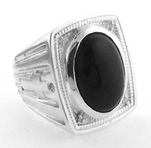 Sterling Silver Black onyx and cubic zirconia ring weighing 32.9 grams.   Ring takes a 18 x 13mm cabochon black onyx. (can be changed to amethyts or simulated ruby for extra charge)   Has four  1.7mm cubic zirconia.
