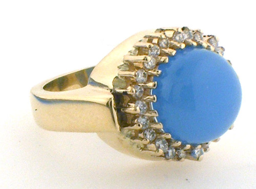 14 karat yellow gold calcedony and diamond ring weighing 13.1 grams. Finger size 6.75. Diamond weigh approx .50ct tw.