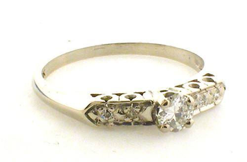 14 karat white gold diamond engagement ring weighing 2.3 grams. Finger size 8Full, Diamond approx .20ct H-I, VS