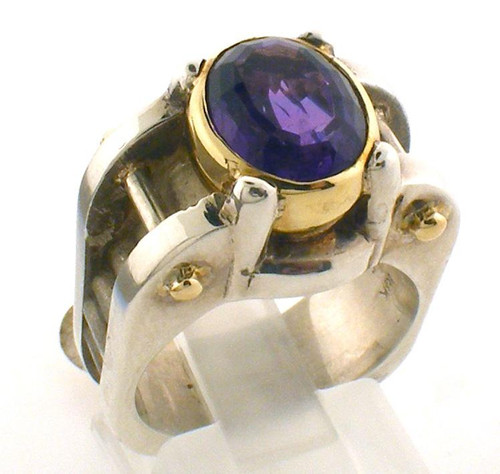 This is a custom made two tone ring featuring an amethyst bezel set in 18 karat yellow gold and two bars that cross the ring on either side of the amethyst.  Ring is a size 6.5 and weights 14.9 grams.