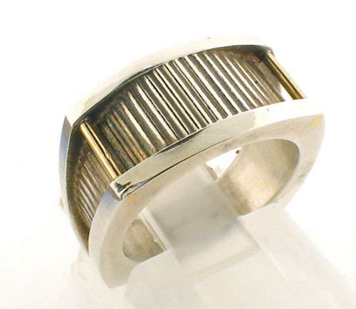 This is a Sterling Silver Custom made ring with two gold bars.  Ring is a size 4 and weighs 8.1 grams.