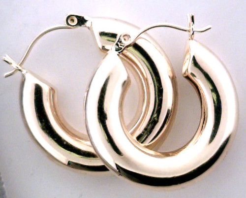 14 karat yellow gold hoop earrings weighing 2.8 grams.  Have a slight dent sold as is