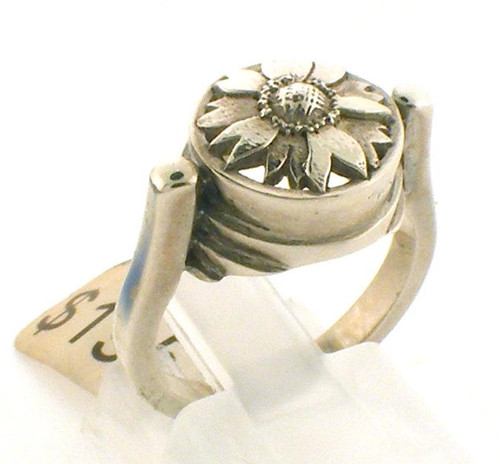 This is a custom designed sterling silver sunflower ring.  Sunflower top is 12 x 12mm round.  Ring is a size 5.5 and weighs 6.6 grams.