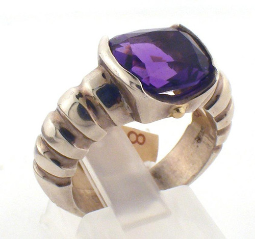 Sterling silver and amethyst custom designed ring with gold beads on the side.  Amethyst is a 10 x 8 mm and is set into a half bezel.  Ring is a size 7 and weighs 9 grams.