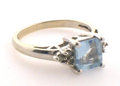 14 karat white gold aquamarine and diamond ring weighing2.6 grams. size 5