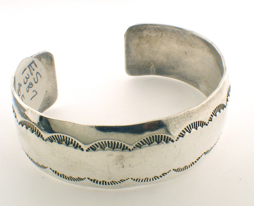 sterling silver bangle bracelet weighing 28.1 grams.